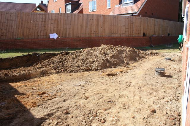 Lawn, builder's rubble and orange clay..