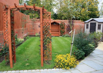 Archway into new cottage garden
