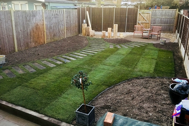 Curved timberstone pathway and lawn