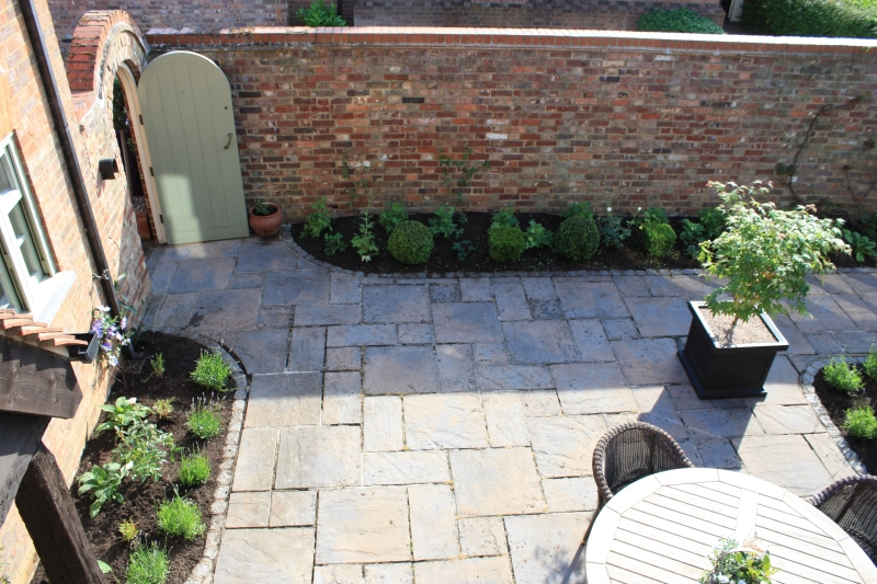 A courtyard garden in need of a planting plan..
